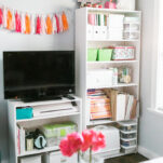 Office Makeover - Amber Oliver. Bright and cheerful office space with floral fabric wall. Photo by thinkelysian.com