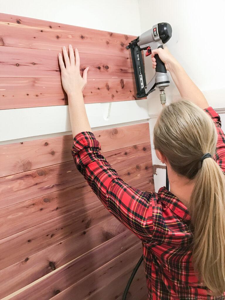 putting up beautiful cedar closet lining