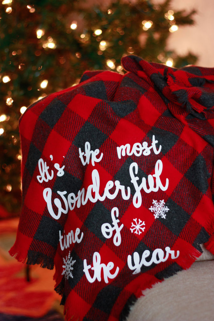 diy flannel blanket in front of christmas tree