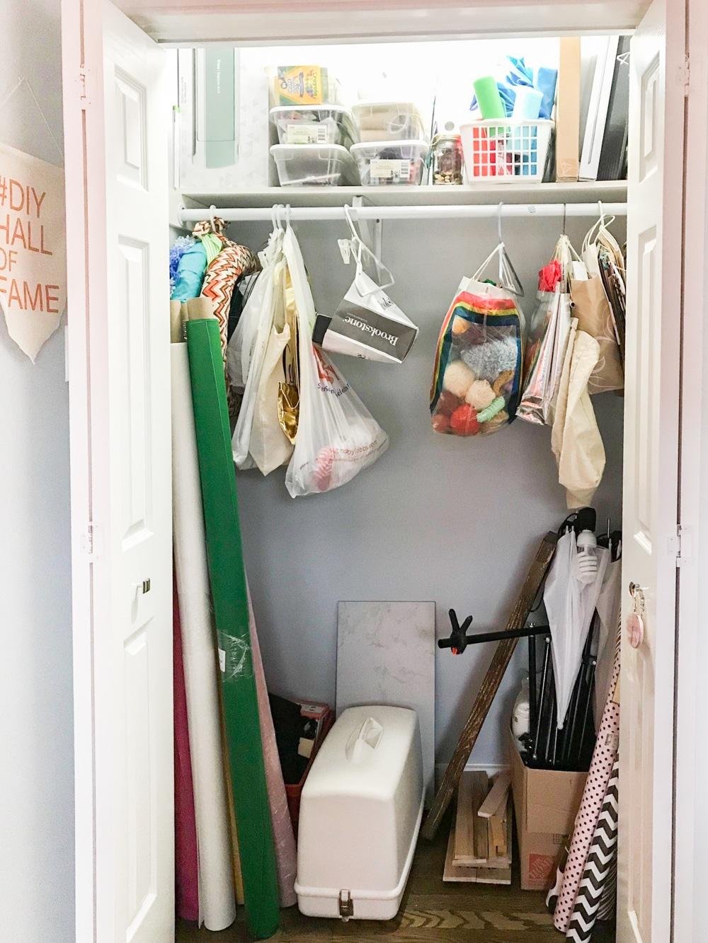 Messy craft closet before we built DIY closet shelves