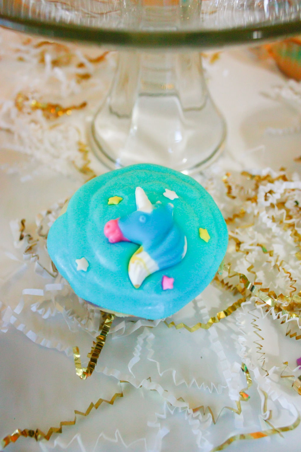 Close up of Unicorn cupcakes with unicorn candy and easy homemade icing!