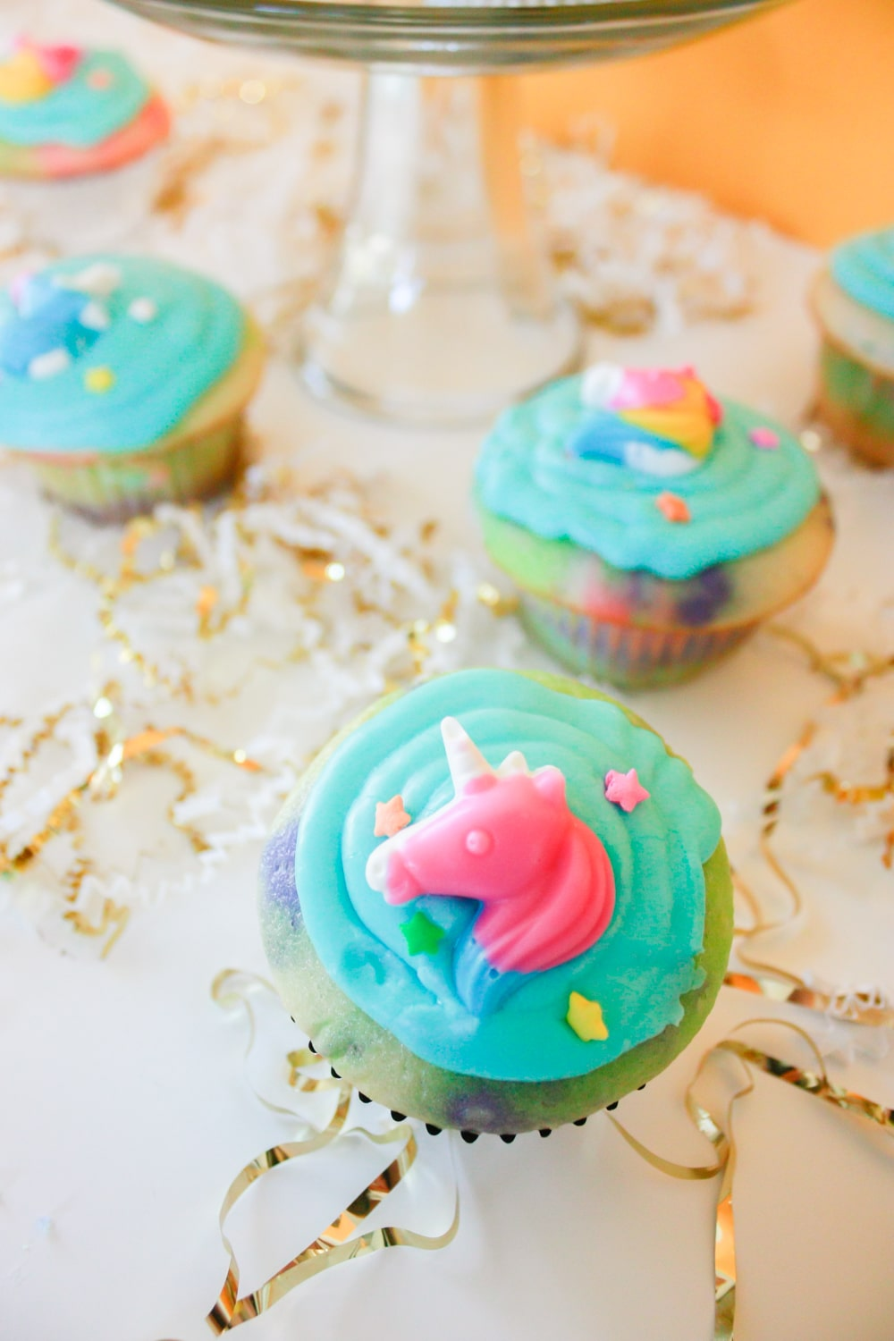 Unicorn cupcakes with unicorn candy and easy homemade icing!