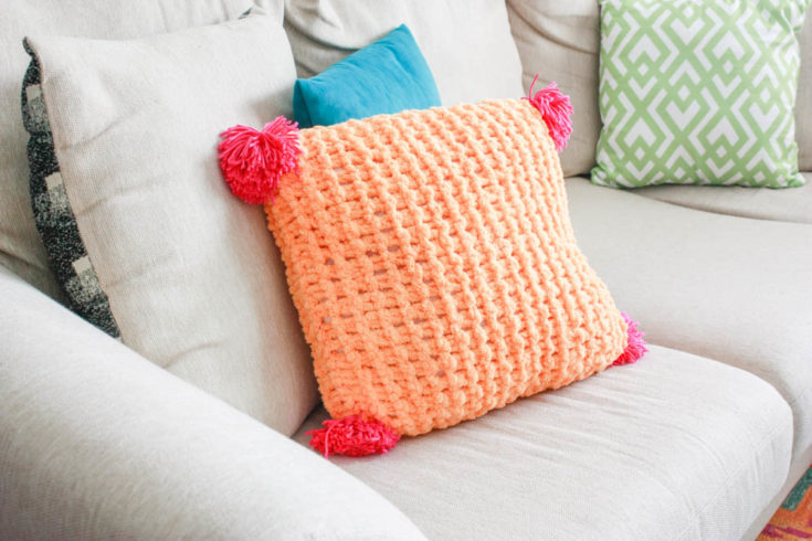loopity loops pillow on a couch