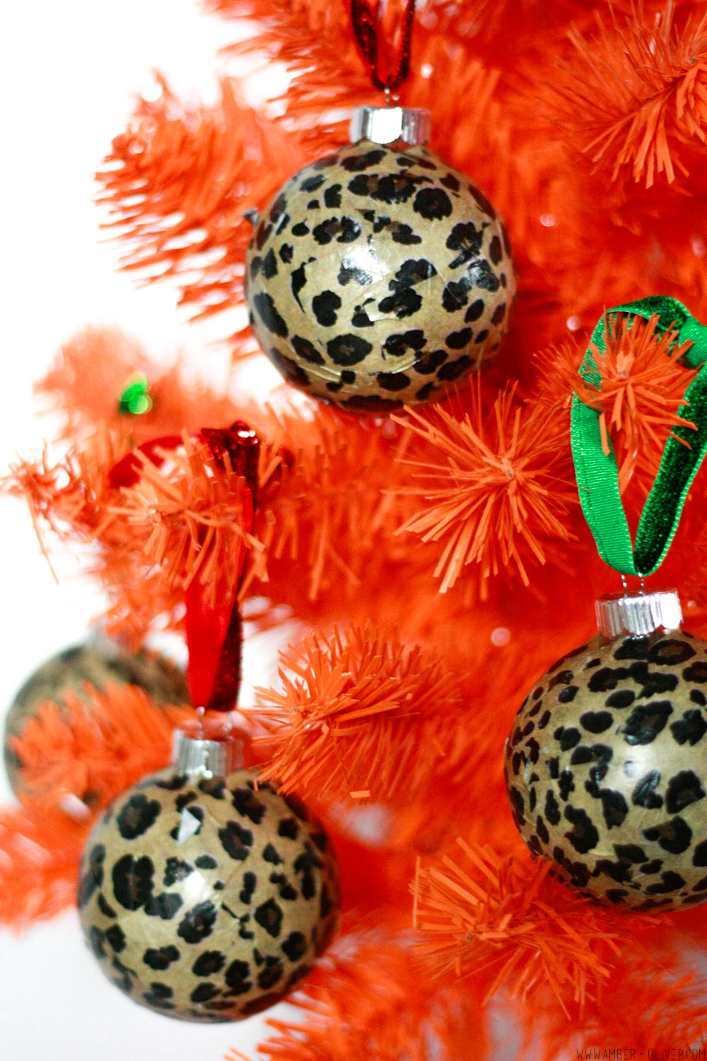 close up view of DIY Leopard Print Ornaments - easy to make modge podge tissue paper Christmas ornaments!