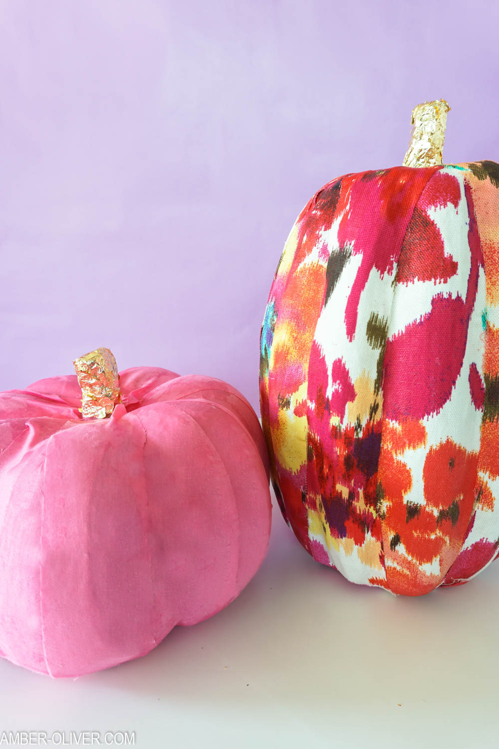 cardboard pumpkins covered in colorful fabric