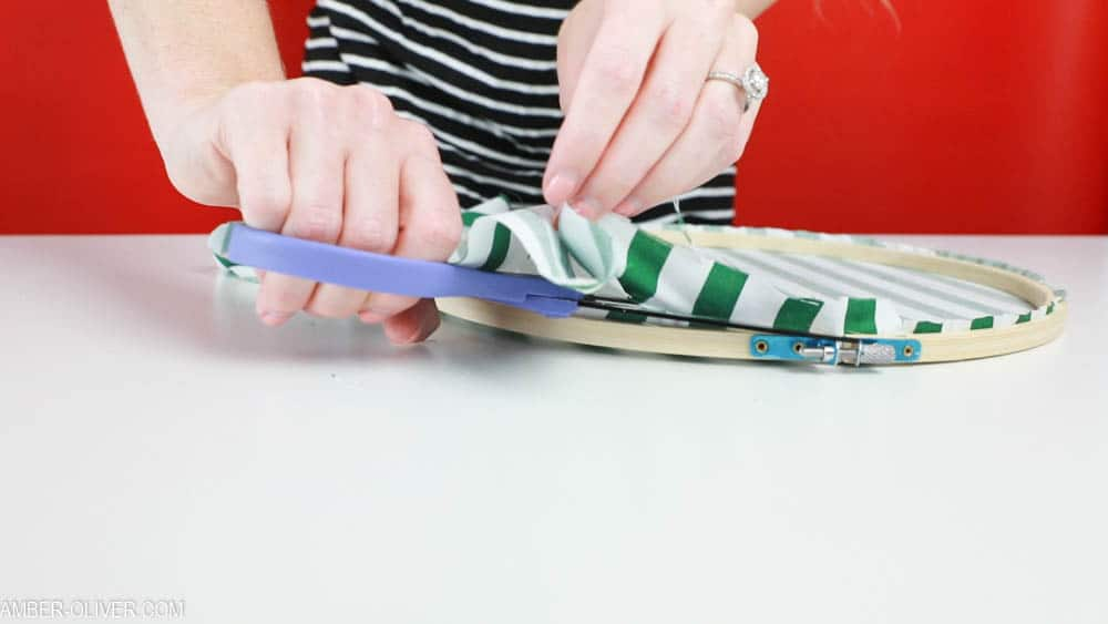 Cutting excess fabric for Fabric Holiday Hoops (Embroidery Hoop Crafts)