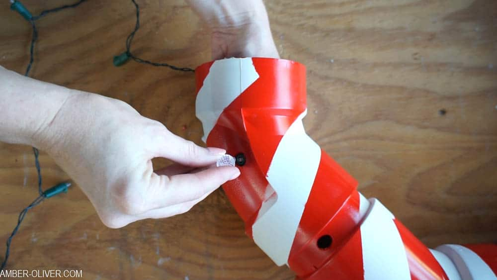 inserting lights into lighted pvc candy canes