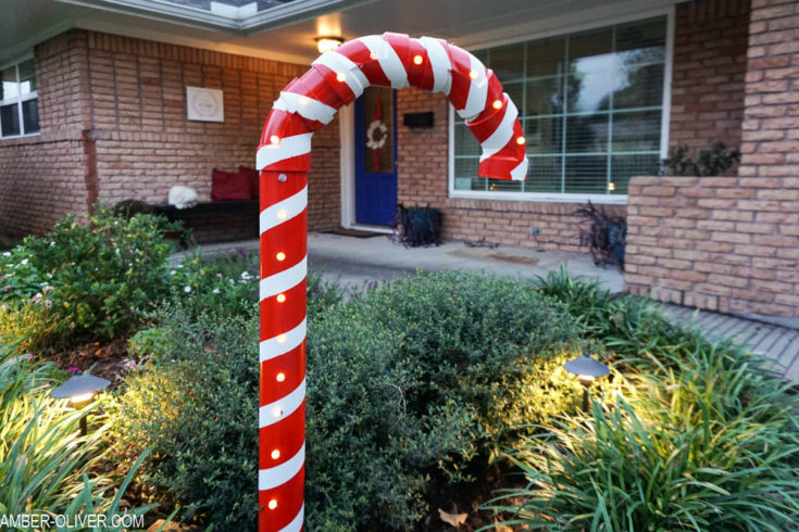DIY Lighted PVC Candy Canes in garden