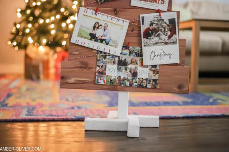 close up shot of a cedar DIY Christmas card holder with holiday cards on it