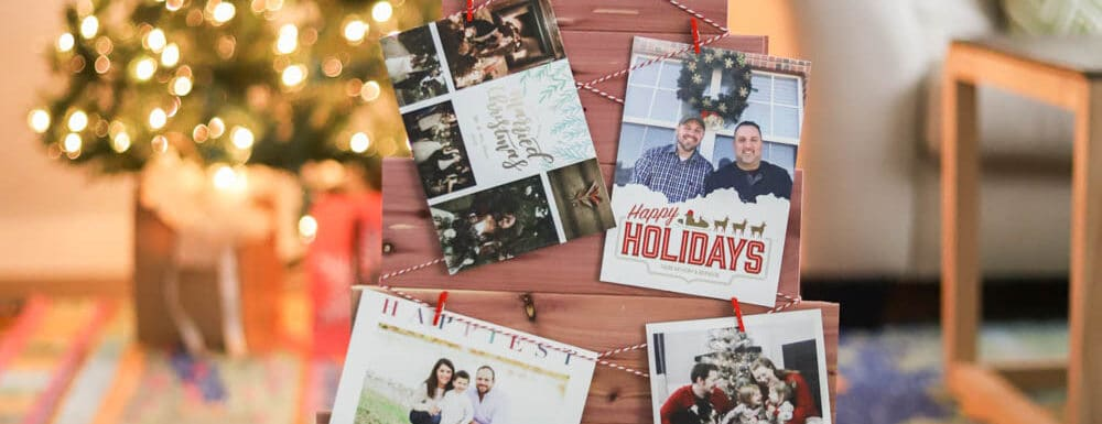 DIY christmas card holder in front of a brightly lit tree