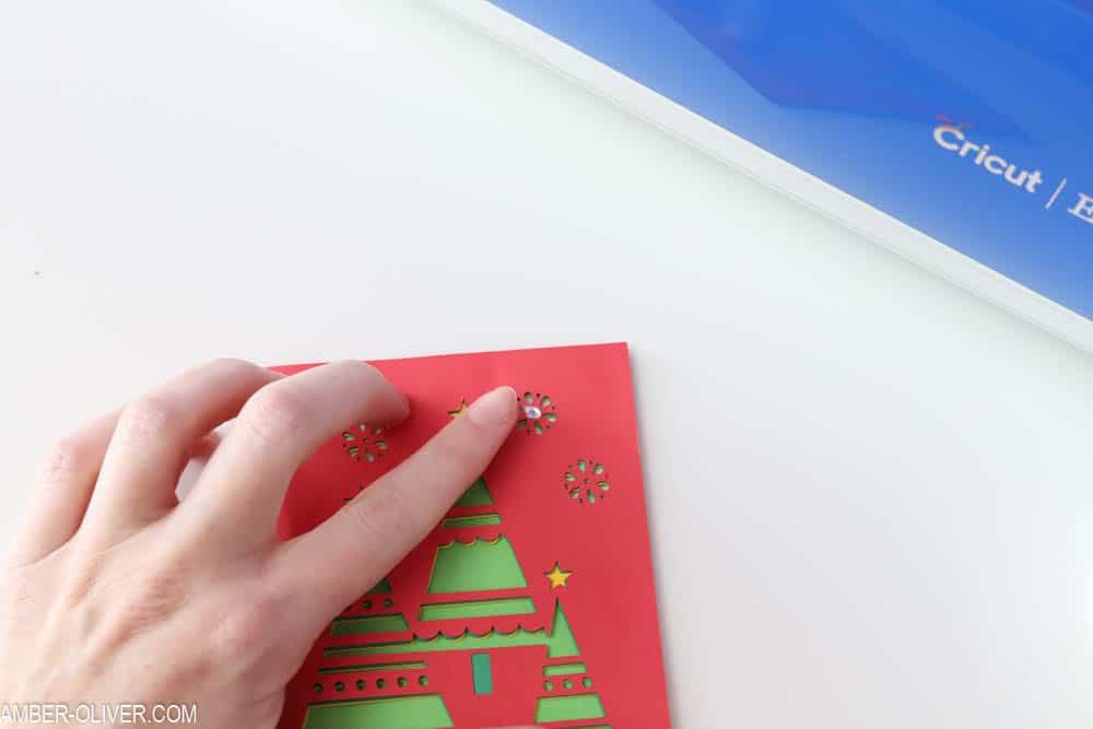 adding rhinestones to handmade christmas card