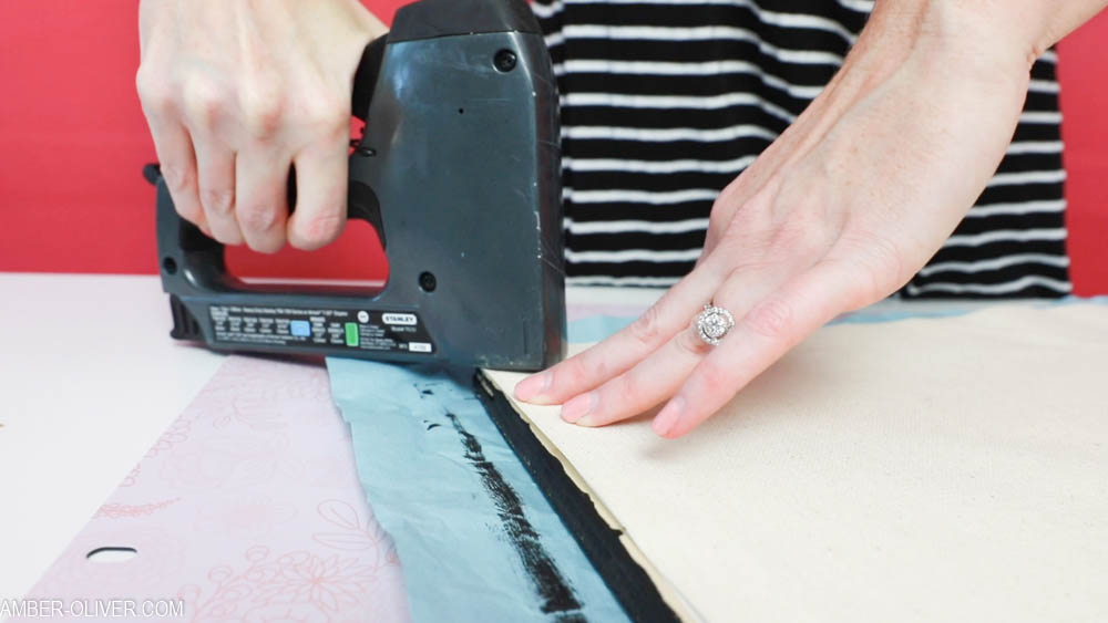 stapling reverse canvas signs
