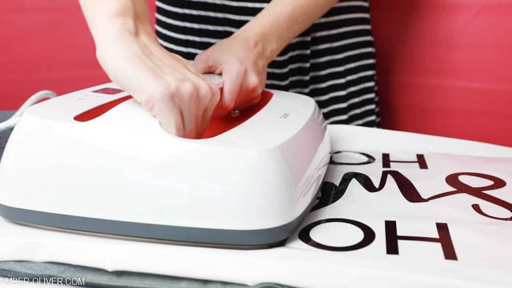 using the cricut easypress 2 to create reverse canvas signs