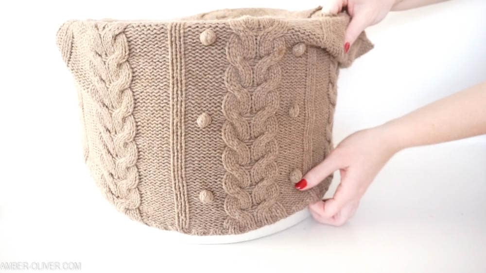 sliding an upcycled sweater onto an old lampshade