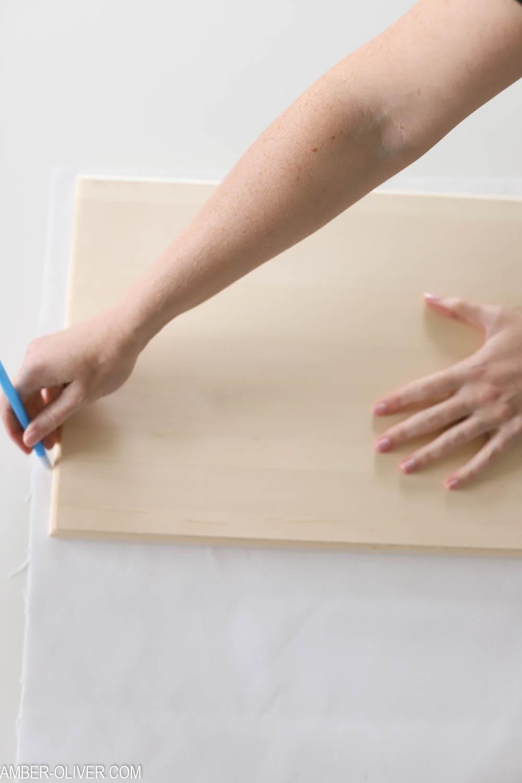 cutting heavy duty fabric to create DIY wall hanging