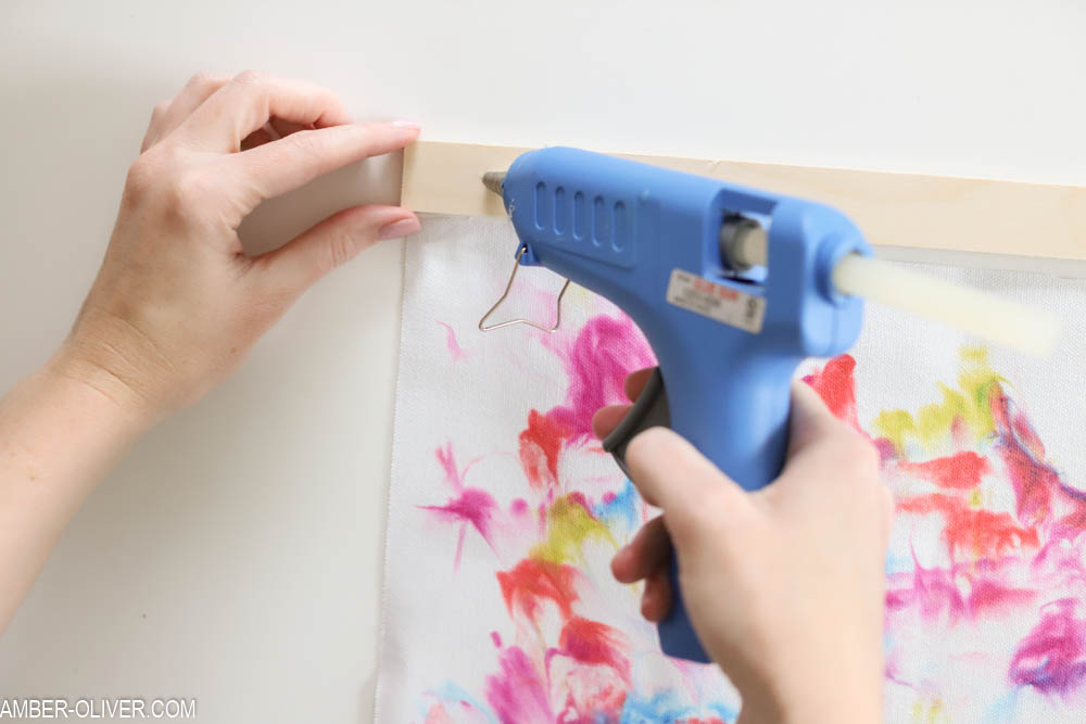gluing wood to create diy wall hanging