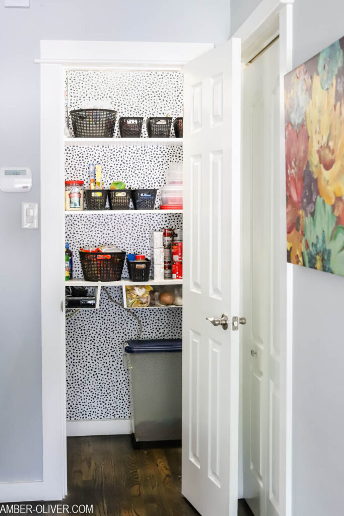 organized pantry decorated with peel and stick wallpaper from Target