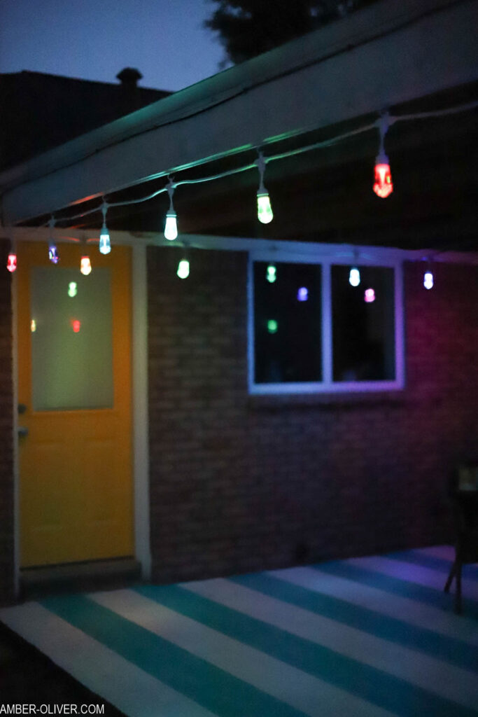 led color changing lights hanging in the dark on a patio outside