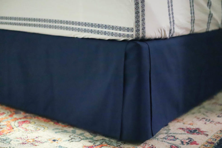 close up shot of navy blue diy bed skirt