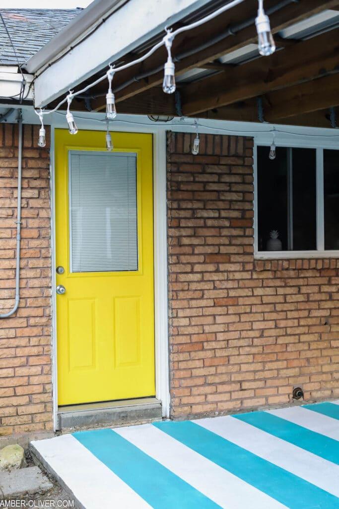 painted back door and patio concrete floor