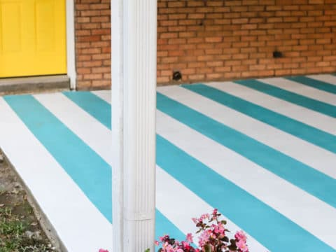 painted patio concrete and yellow back door