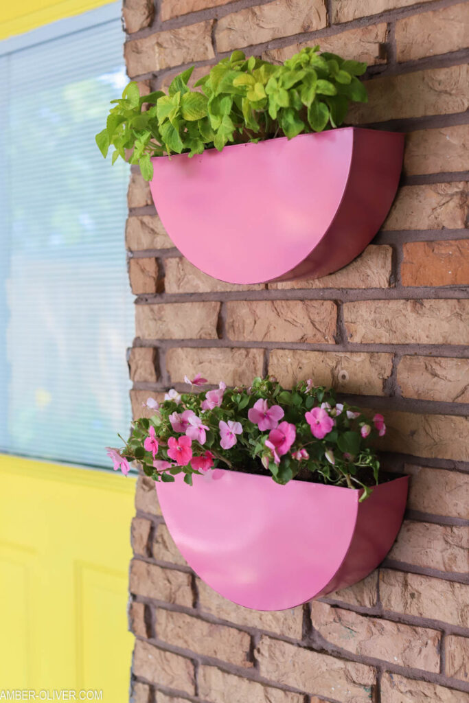 close up of metal planters painted with pink COLORSHOT spray paint