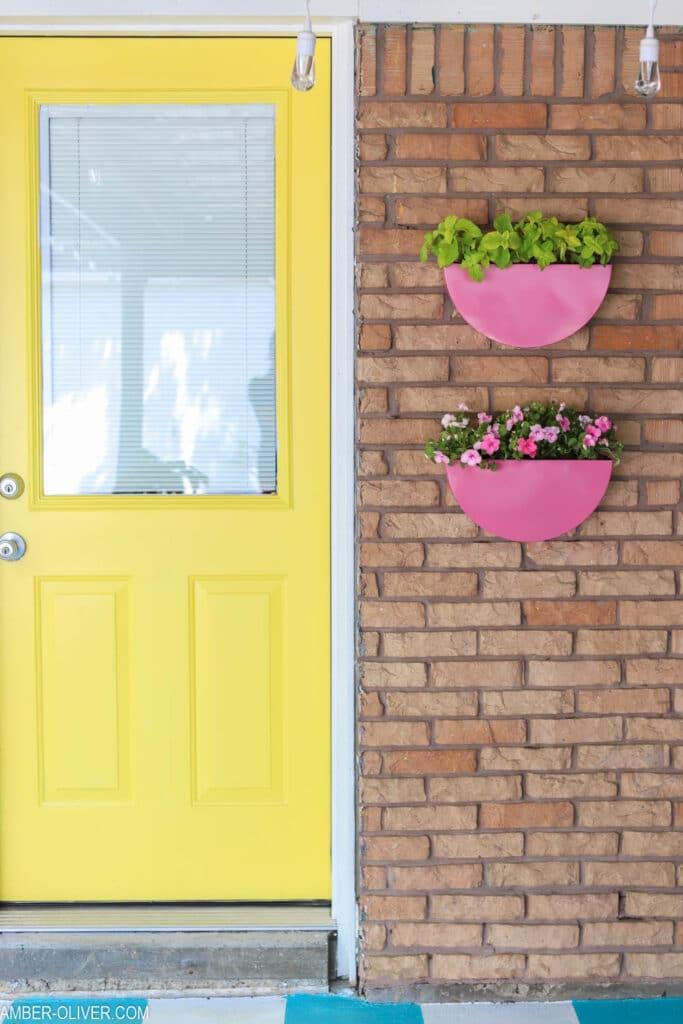 painted metal planters hanging by back door
