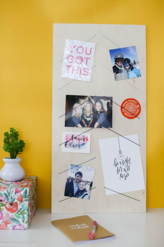 a diy bulletin board in front of a bright yellow background