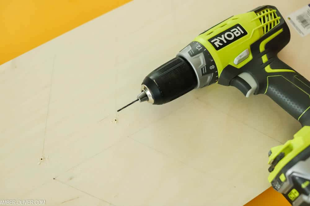 drill holes to create a DIY bulletin board