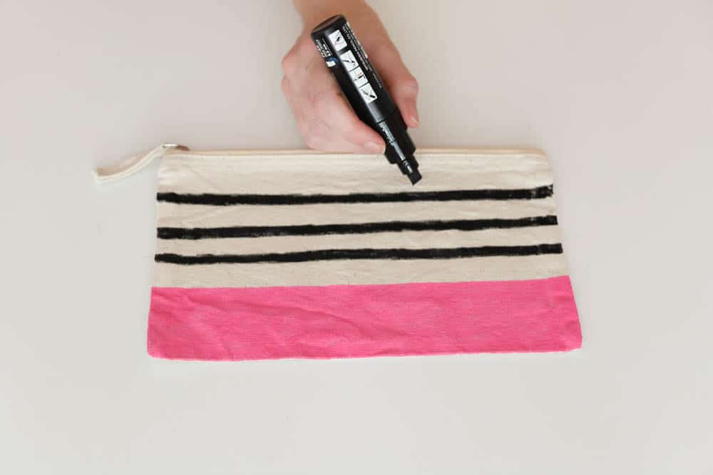 adding stripes with paint pens to create modern color block zip pouches