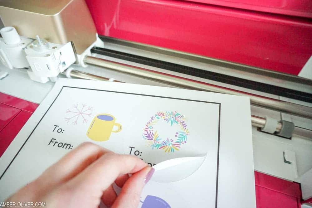 peeling DIY gift tags created with Cricut print then cut