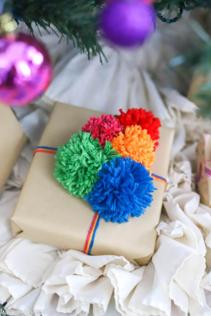 pom poms on a christmas gift
