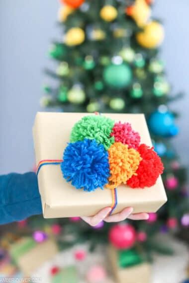 colorful handmade pom poms for creative gift wrap