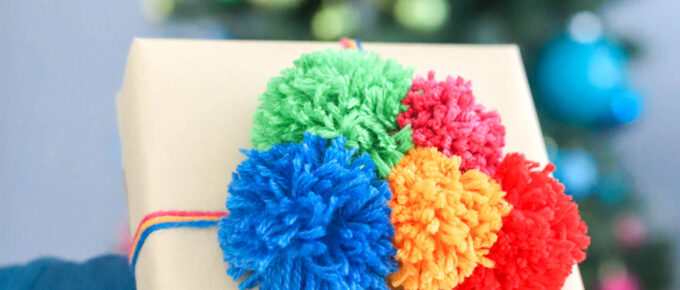 colorful handmade pom poms for creative gift wrap