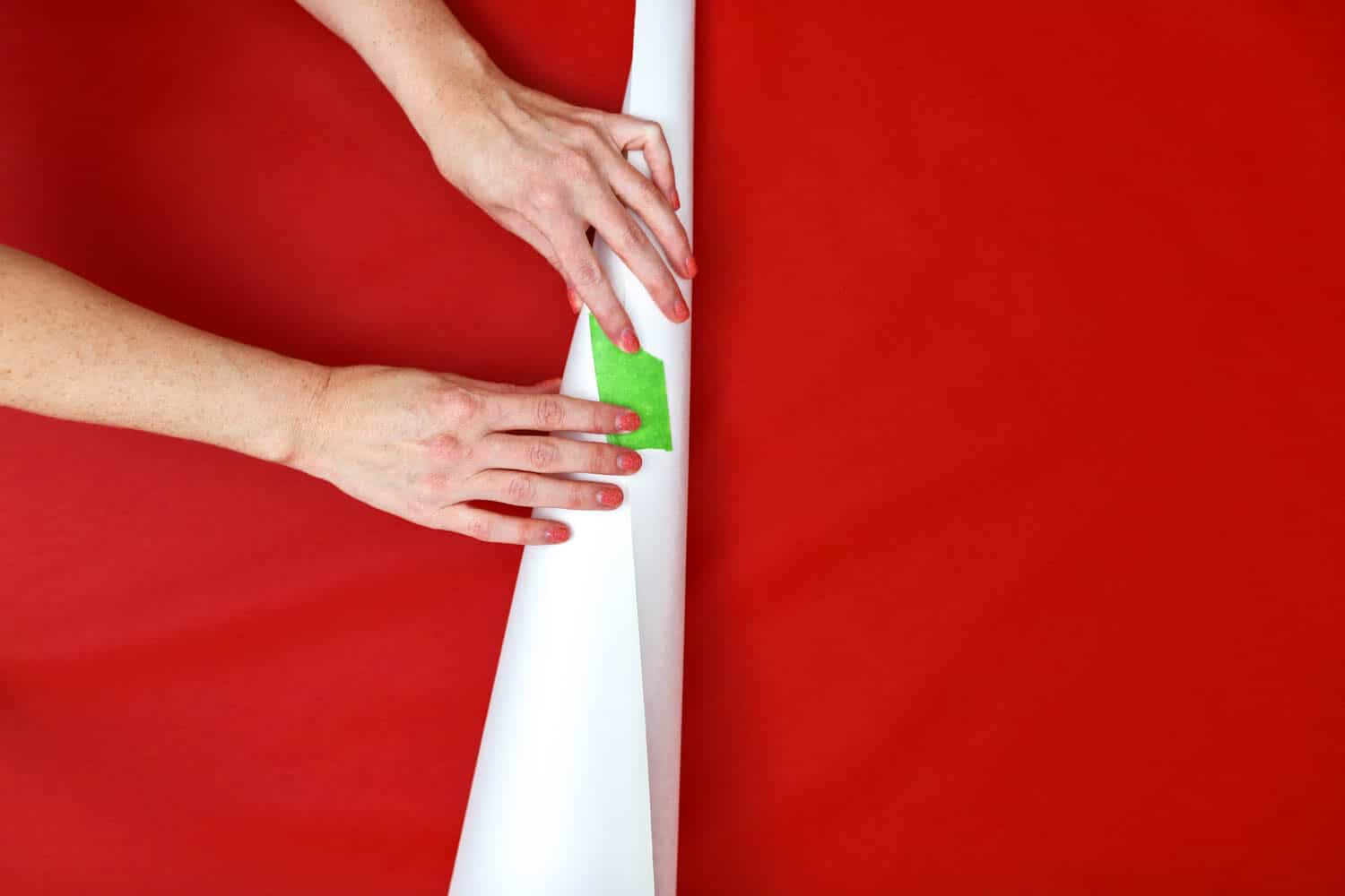 taping posterboard to create cone christmas trees