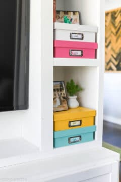 colorful diy memory boxes stacked in a DIY entertainment center
