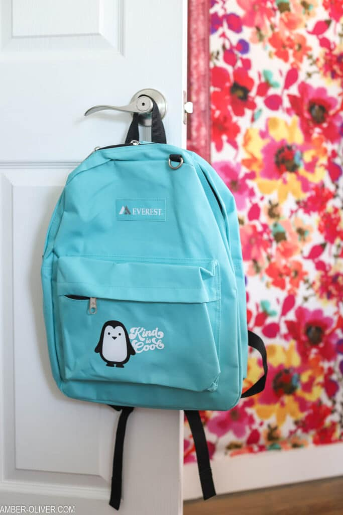 blue backpack with penguin vinyl