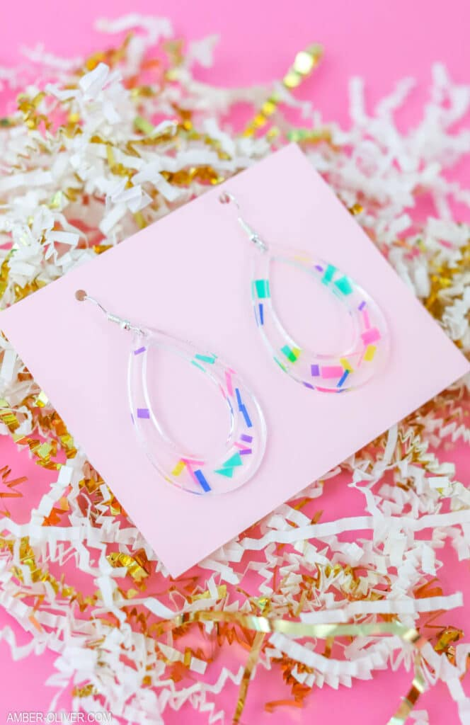 beautiful confetti earrings made from resin on a pink background
