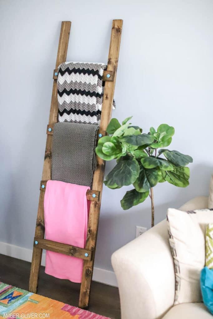 diy blanket ladder leaning against living room wall