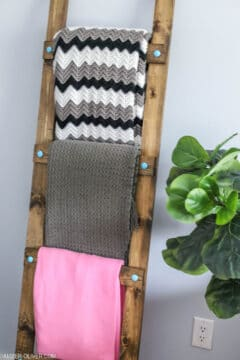 diy blanket ladder leaning on a wall