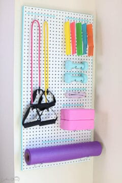 adorable DIY pegboard for home gym small space organizer
