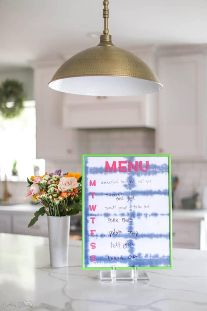 diy kitchen menu board sitting on counter in kitchen