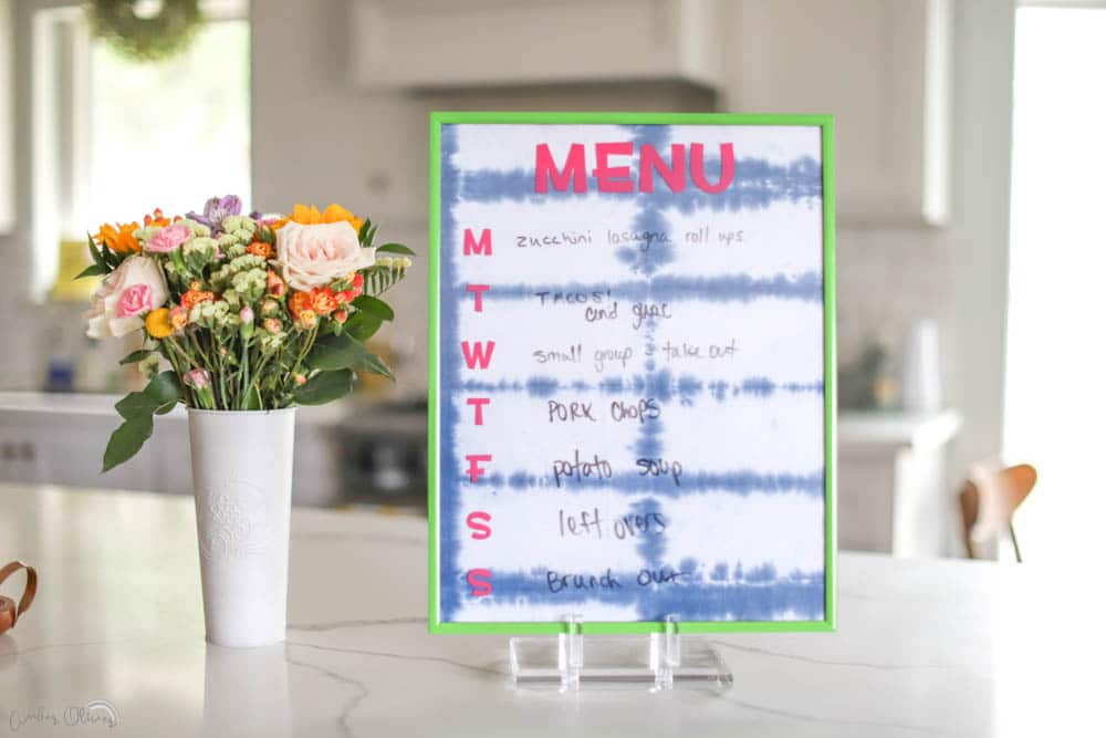 a diy kitchen menu made from thrifted home decor