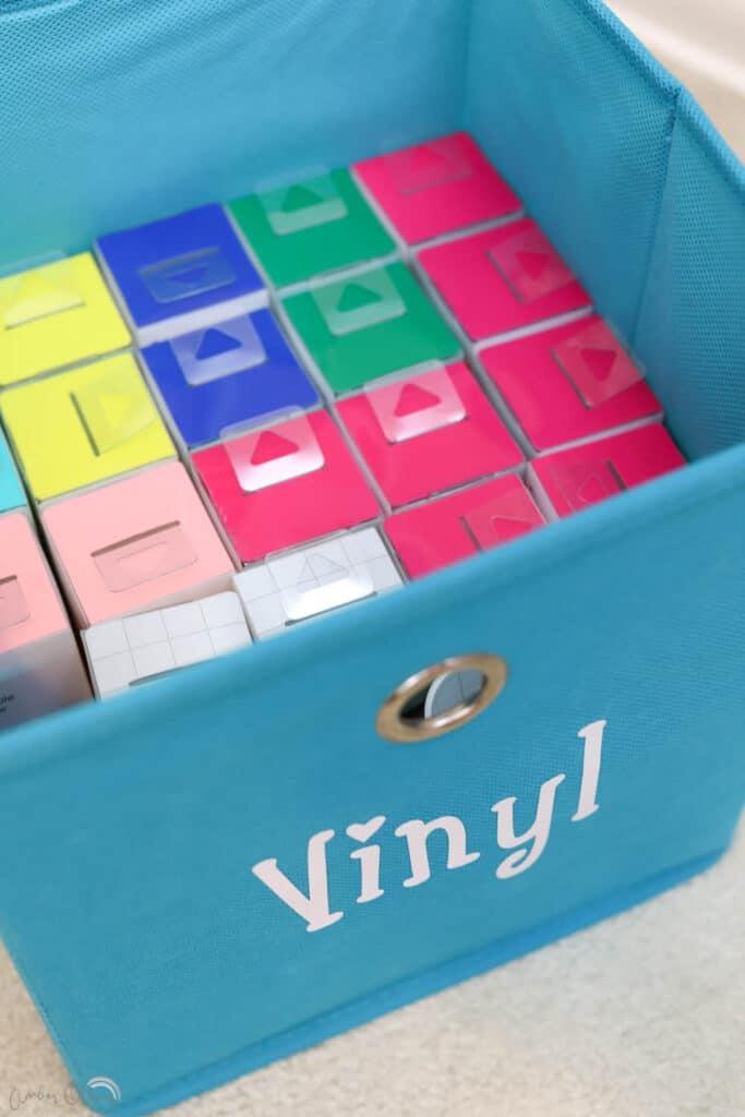 storage bin labels from vinyl on blue bins