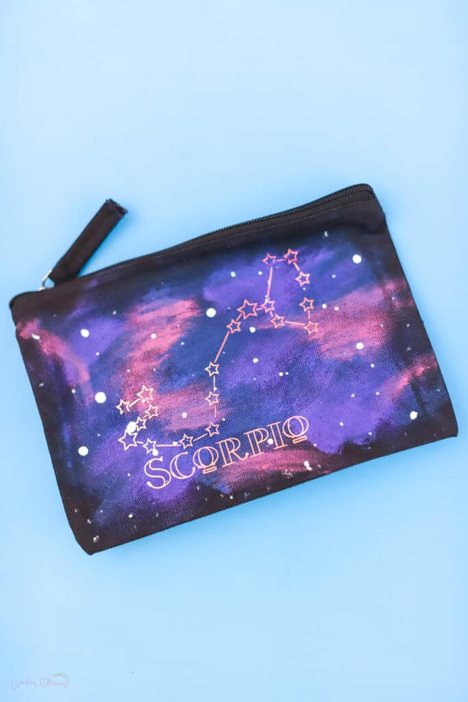 galaxy painted bag on a blue background