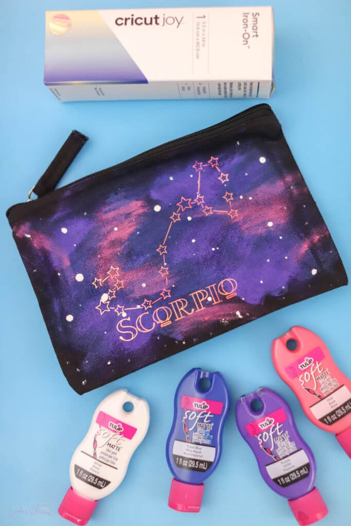 everything needed to paint a galaxy on a bag with fabric paint