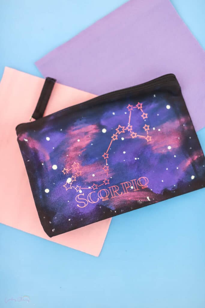 paint a galaxy on a bag with fabric paint and add your astrological sign