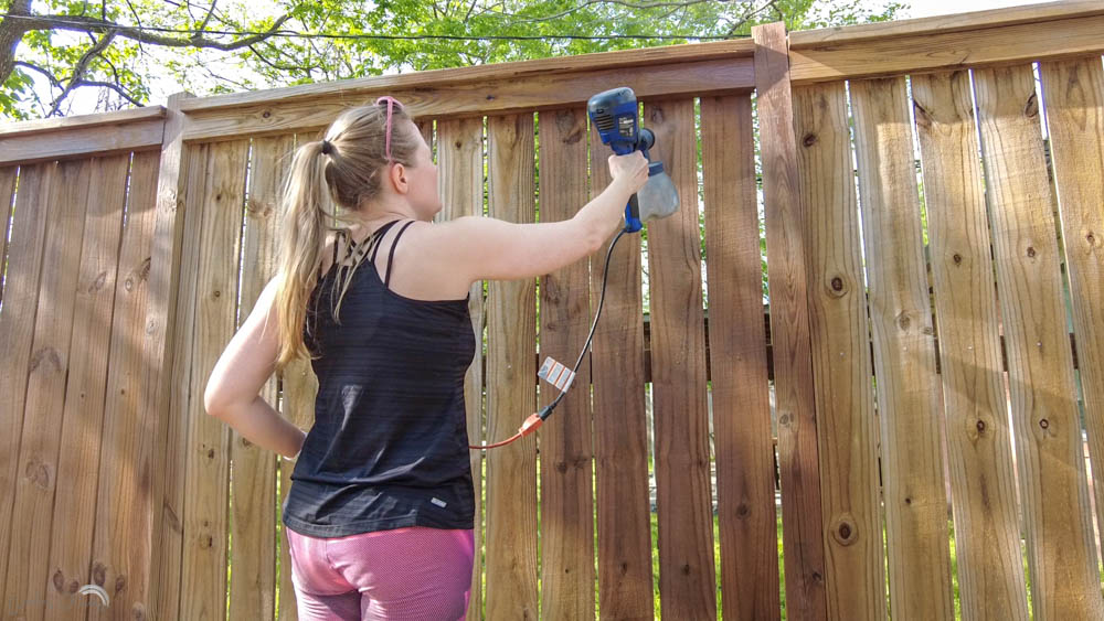 stain a fence quickly and easily with a paint sprayer