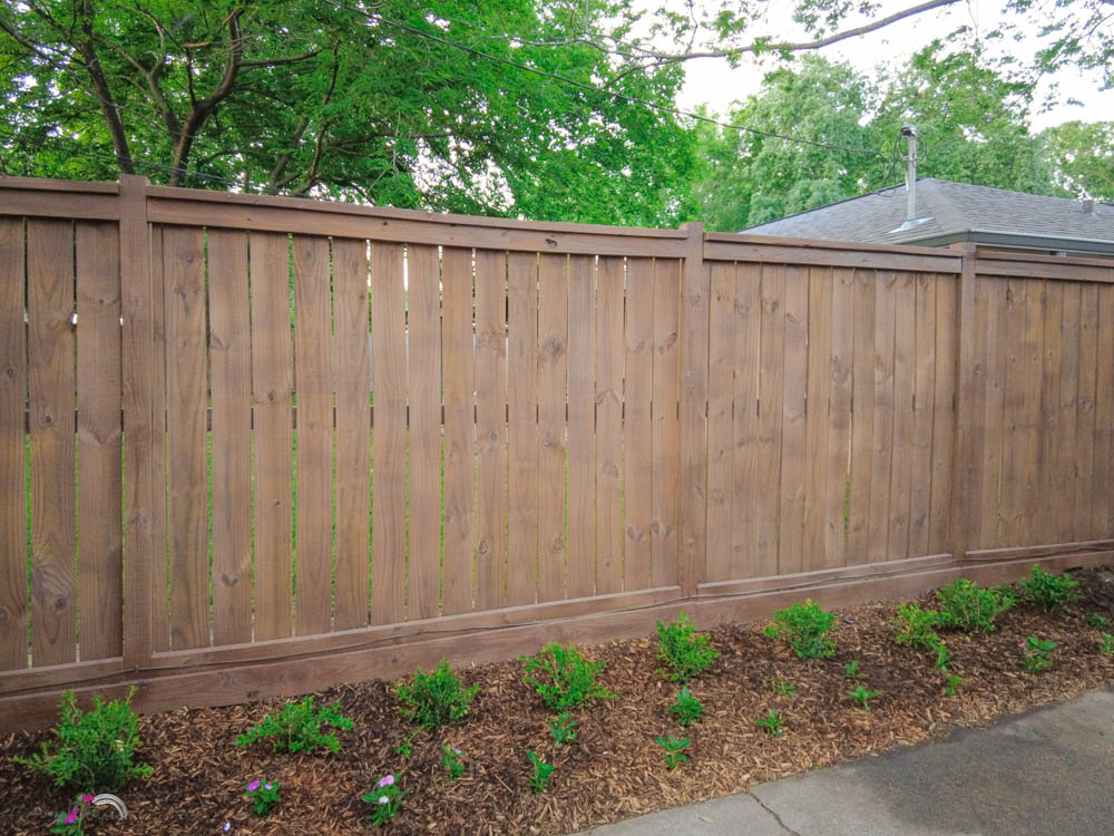 our DIY wood fence with wood stain