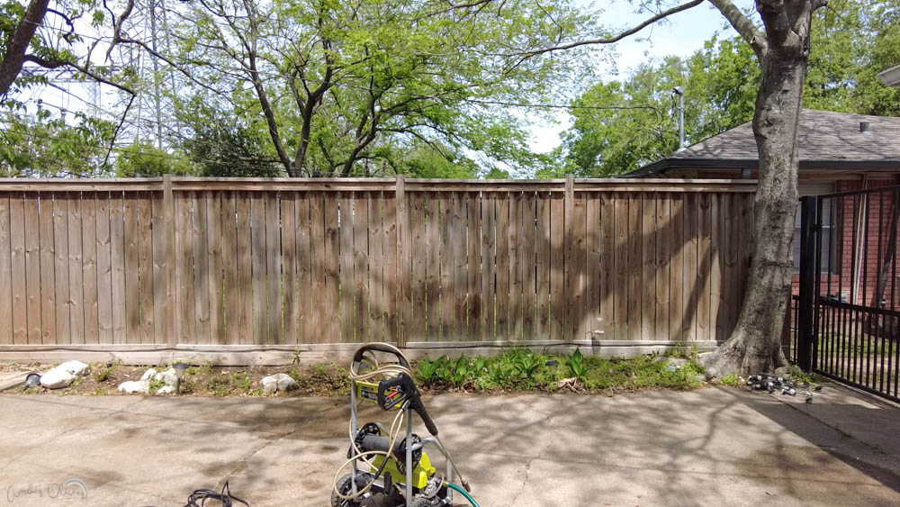 DIY wood fence before using a paint sprayer to add wood stain